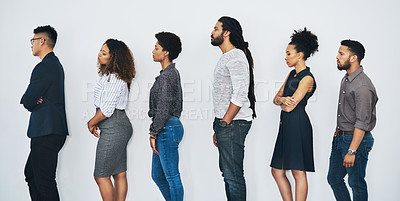 Buy stock photo Studio shot of a group of businesspeople standing in line against a white background