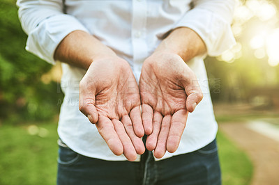Buy stock photo Closeup shot of an unrecognizable man standing with his hands cupped together