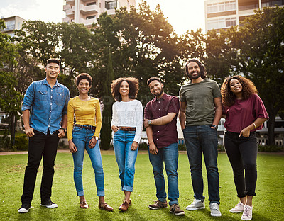 Buy stock photo Shot of a group of friends standing together at the park