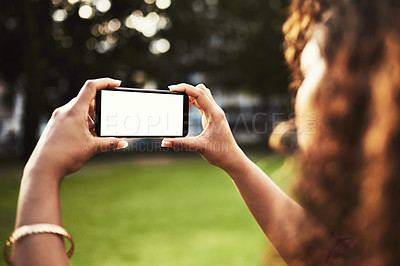 Buy stock photo Shot of a young woman photographing the scenery outside