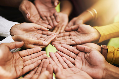 Buy stock photo Cropped shot of a group of people standing with their hands cupped