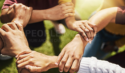 Buy stock photo Cropped shot of a group of people linking their arms in solidarity