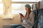 On the train with her tablet
