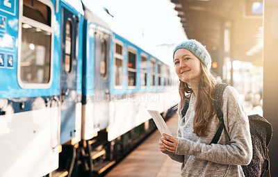 Buy stock photo Cropped shot of an attractive young woman waiting for a train at the station