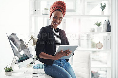 Buy stock photo Cropped portrait of an attractive young businesswoman working on her digital tablet in the office