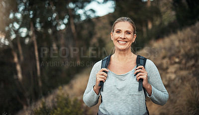 Buy stock photo Portrait of a mature woman hiking through the mountains
