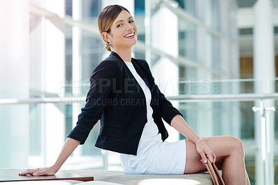 Buy stock photo Cropped portrait of an attractive young businesswoman sitting in a waiting room