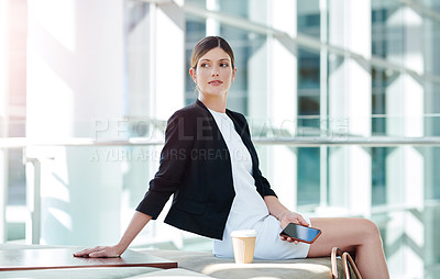 Buy stock photo Cropped shot of an attractive young businesswoman sitting in a waiting room