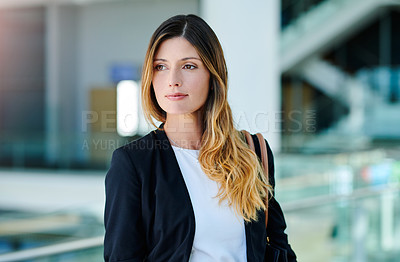 Buy stock photo Cropped shot of an attractive young businesswoman standing in her office