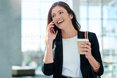 Buy stock photo Cropped shot of an attractive young businesswoman taking a phone call in an office