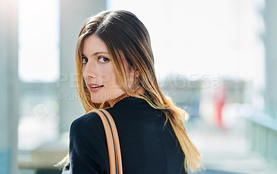 Buy stock photo Cropped portrait of an attractive young businesswoman walking through a modern office