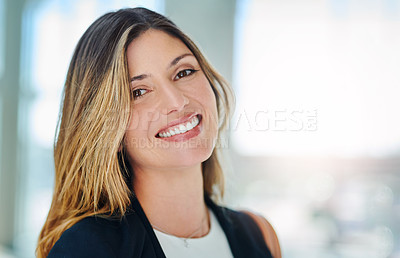 Buy stock photo Cropped portrait of an attractive young businesswoman smiling confidently in her office