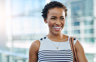 Buy stock photo Cropped shot of an attractive young woman smiling confidently in an office