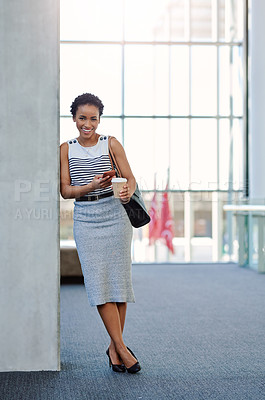 Buy stock photo Cropped portrait of an attractive young businesswoman standing in her workplace