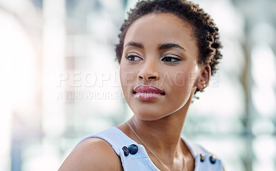 Buy stock photo Cropped shot of an attractive young woman looking thoughtful in her workplace