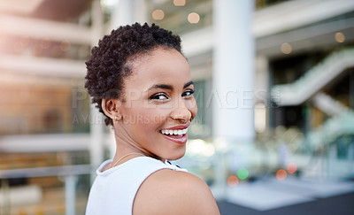 Buy stock photo Cropped portrait of an attractive young woman smiling confidently in her workplace