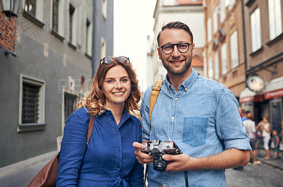 Buy stock photo Cropped shot of a couple out exploring a foreign city