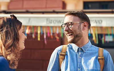 Buy stock photo Cropped shot of a young couple exploring a foreign city