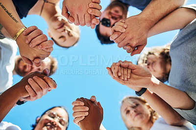 Buy stock photo Cropped shot of a group of people holding hands