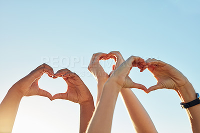 Buy stock photo Cropped shot of a group of people forming a heart shape with their hands