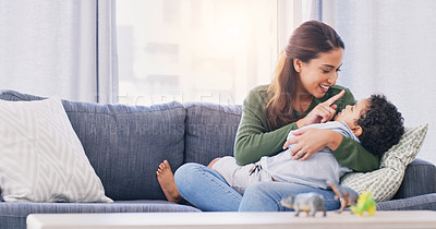 Buy stock photo Cropped shot of an attractive young woman and her son bonding in their living room