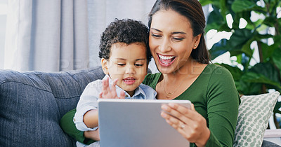 Buy stock photo Cropped shot of an attractive young woman and her son using a digital tablet in their living room