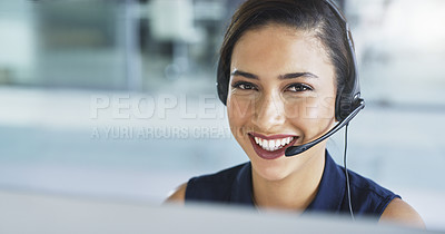 Buy stock photo Portrait of a cheerful young businesswoman talking on a headset to clients while working inside of the office