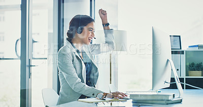 Buy stock photo Cropped shot of a cheerful young businesswoman talking on a headset to clients while working inside of the office