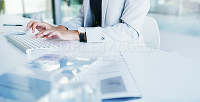 Buy stock photo Cropped shot of an unrecognizable young businesswoman working on a computer inside of the office