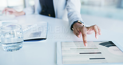 Buy stock photo Cropped shot of an unrecognizable young businesswoman browsing on a digital tablet inside of the office