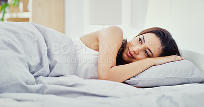Buy stock photo Shot of an attractive young woman lying in her bed in her bedroom at home