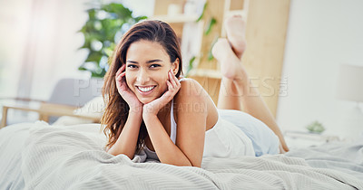 Buy stock photo Full length shot of an attractive young woman lying down on her bed at home