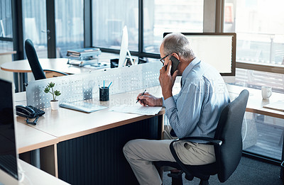 Buy stock photo Cropped shot of a mature businessman using his cellphone at his desk