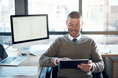 Buy stock photo Cropped shop of a businessman using a digital tablet at his desk
