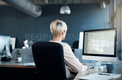 Buy stock photo Cropped shot of a mature businesswoman working in a modern office