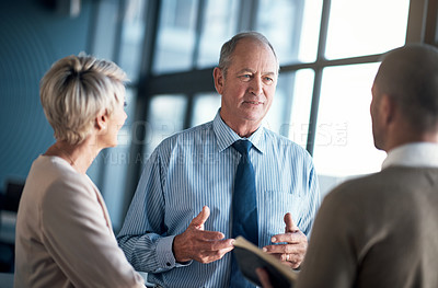 Buy stock photo Shot of a group of businesspeople having a discussion in an office