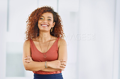 Buy stock photo Portrait of a confident young businesswoman standing in an office