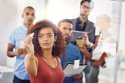 Buy stock photo Cropped shot of a group of businesspeople making notes on a glass board inside of the office during the day