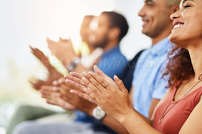 Buy stock photo Cropped shot of a group of cheerful people clapping hands while being seated at a seminar during the day