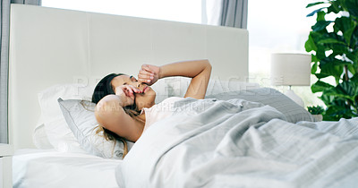 Buy stock photo Cropped shot of a tired young woman waking up after a nights rest during the morning hours