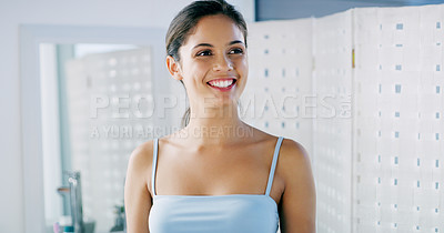 Buy stock photo Cropped shot of a cheerful young woman looking at her reflexion in the mirror in the morning after waking up