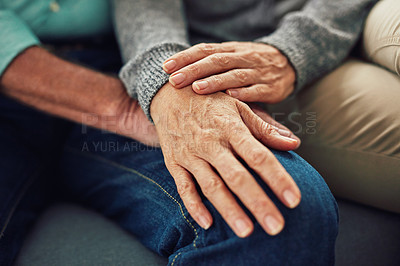 Buy stock photo Shot of an unrecognizable senior couple holding hands indoors