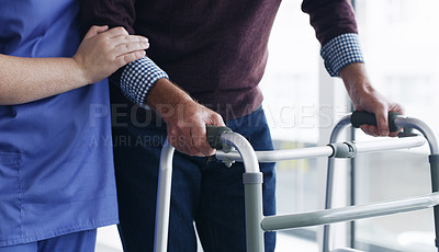 Buy stock photo Shot of a senior man using a walker with the assistance of a nurse