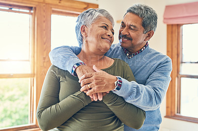 Buy stock photo Shot of an affectionate senior couple posing together in their home