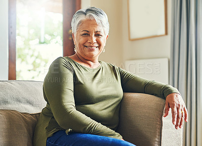 Buy stock photo Portrait of a senior woman relaxing on a sofa at home