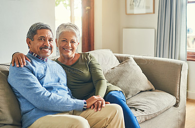 Buy stock photo Portrait of an affectionate senior couple relaxing on a sofa together at home