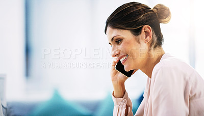 Buy stock photo Shot of an attractive businesswoman taking a phone call in her office