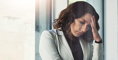 Buy stock photo Cropped shot of an attractive young businesswoman feeling stressed out at work