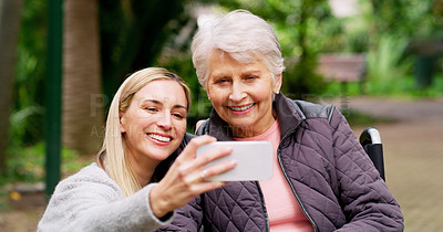Buy stock photo Cropped shot of a cheerful elderly woman and her daughter taking a self portrait together outside in a park