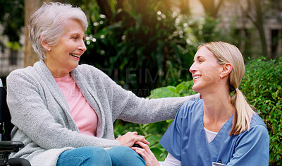 Buy stock photo Cropped shot of a cheerful elderly woman in a wheelchair spending time with her daughter outside in a park